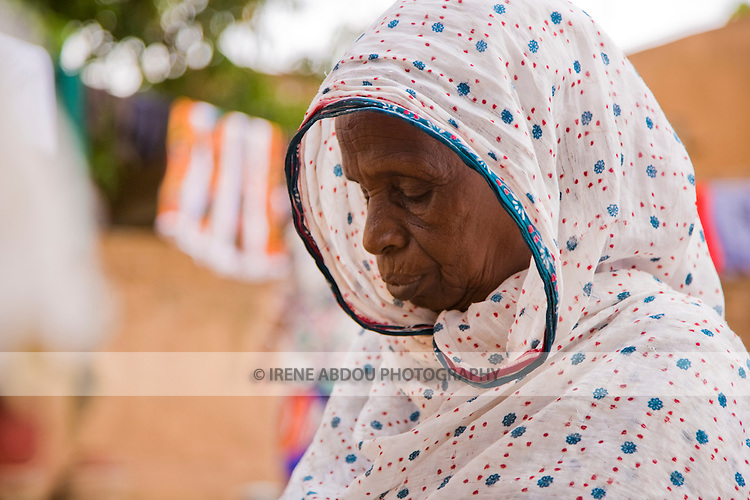 In Ouagadougou, Burkina Faso, Binta Moussa bends her head in prayer.  The Fulani people are typically Muslim.  Traditionally pastoralist, they can be found throughout West Africa, crisscrossing the continent in search of water and green pastures for their cattle.