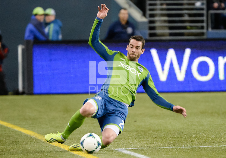 November, 2013: CenturyLink Field, Seattle, Washington:  Seattle Sounders FC defender Zach Scott (20) slides to keep the ball in bounds as the Portland Timbers defeat  the Seattle Sounders FC 2-1 in the Major League Soccer Playoffs semifinals Round.