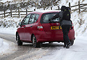 08/12/17<br /> <br /> A walker lends a hand and pushes a car up the road to Mam Tor, near Castleton in the Derbyshire Peak District.<br />   <br /> All Rights Reserved F Stop Press Ltd. +44 (0)1335 344240 +44 (0)7765 242650  www.fstoppress.com
