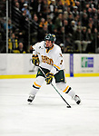 6 November 2009: University of Vermont Catamount defenseman Drew MacKenzie, a Sophomore from New Canaan, CT, in second period action against the University of Massachusetts Lowell River Hawks at Gutterson Fieldhouse in Burlington, Vermont. The Hockey East rivals battled to a 3-3 tie. Mandatory Credit: Ed Wolfstein Photo