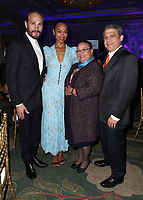 LOS ANGELES, CA - NOVEMBER 8: Marco Perego Saldana, Zoe Saldana, Dagoberto Galan and Asalia Nazario at the Eva Longoria Foundation Dinner Gala honoring Zoe Saldaña and Gina Rodriguez at The Four Seasons Beverly Hills in Los Angeles, California on November 8, 2018. Credit: Faye Sadou/MediaPunch