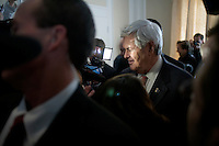 Surrounded by media, former Speaker of the House Newt Gingrichs leaves after speaking to the Nashua Rotary Club at the Nashua Country Club in Nashua, New Hampshire, on Jan. 9, 2012.  Gingrich is seeking the 2012 Republican presidential nomination.