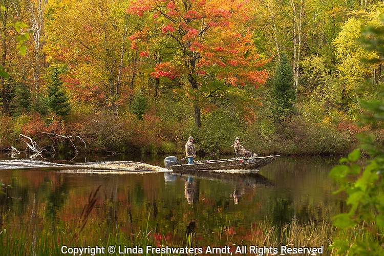 Boaters on the East Fork of the Chippewa River bordering The Chequamegon National Forest.