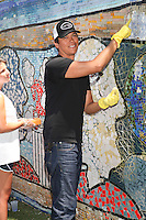 Chaske Spencer celebrates the Bing summer of Doing with dosomething.org by volunteering and restoring CITYarts Mosaic Peace Wall. Harlem, New York. July 10, 2012 © Diego Corredor/MediaPunch Inc.