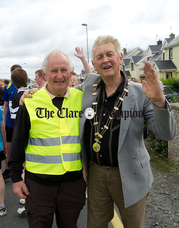 Joe Lillis and Padraig Haugh during the Declan Hayes Memorial Doonbeg Half Marathon/10K Fun Run and Walk. Photograph by John Kelly.