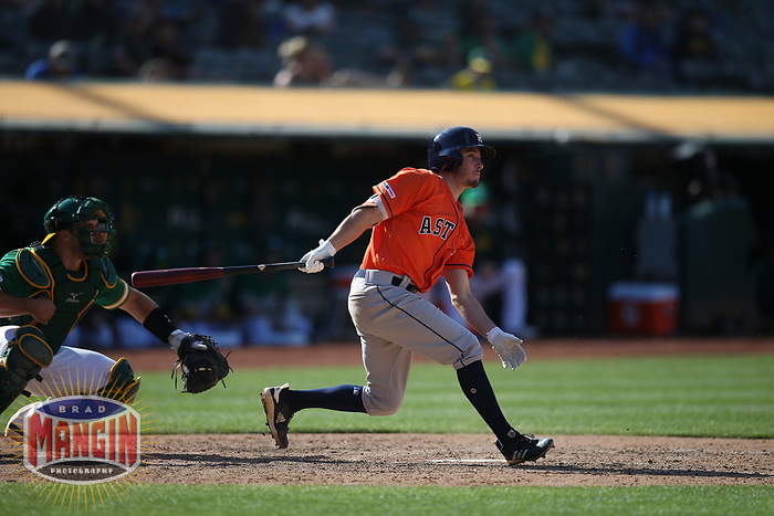 OAKLAND, CA - JUNE 2:  Garrett Stubbs #11 of the Houston Astros bats against the Oakland Athletics during the game at the Oakland Coliseum on Sunday, June 2, 2019 in Oakland, California. (Photo by Brad Mangin)