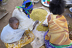 "In a transition camp, or so called ""satellite camp"", Ugandans displaced by two decades of war sort grain as they take one step closer to returning home. They have left the huge displacement camps where they've been sheltered for years and moved into small clusters of huts closer to their original villages, but still receive support from the government and international aid organizations. A peace process that began in 2006 has brought hope to almost two million people displaced by the war that they can soon return all the way home."