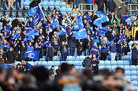Leinster fans in the crowd wave flags in support after the match. European Rugby Champions Cup match, between Wasps and Leinster on January 24, 2015 at the Ricoh Arena in Coventry, England. Photo by: Patrick Khachfe / JMP