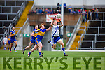 Eye on the ball St Marys Aidan Walsh dose not break stride as he gathers and make little of the challenge from Carrigalines Cillian McSweeney.