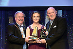 Katie Duffy, UCD Musical &amp; Variety Group who won Best Choreography / Sullivan Section for the show 'In The Heghts' receiving the trophy from on  left, Colm Moules, President, AIMS and Seamus Power, Vice-President at the Association of Irish Musical Societies annual awards in the INEC, KIllarney at the weekend.<br /> Photo: Don MacMonagle -macmonagle.com<br /> <br /> <br /> <br /> repro free photo from AIMS<br /> Further Information:<br /> Kate Furlong AIMS PRO kate.furlong84@gmail.com