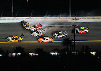 Feb 07, 2009; Daytona Beach, FL, USA; NASCAR Sprint Cup Series driver Jeff Burton (31) races as Joey Logano (20) Scott Speed (82) David Ragan (6) Robby Gordon (7) and Casey Mears (07) crash while Jeff Gordon (24) slows to avoid during the Bud Shootout at Daytona International Speedway. Mandatory Credit: Mark J. Rebilas-