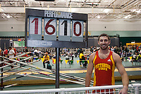 Pittsburg State junior Colbie Snyder poses next to the performance indicator sign after clearing 16-10, a personal record and nationals automatic qualifying mark in winning the pole vault at the 2012 MIAA Indoor Track & Field Championships at Missouri Southern State University in Joplin, MO February, 26.