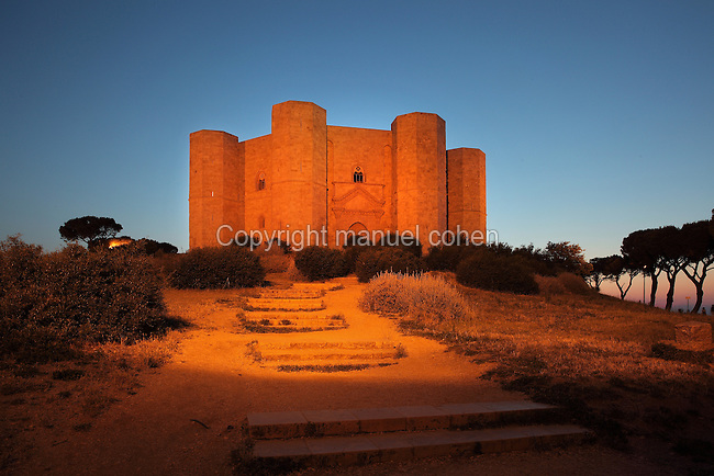 Castel del Monte in the evening, a 13th century citadel and castle in Andria, Puglia, Southern Italy. The castle was built in the 1240s by Emperor Frederick II and is octagonal in plan, with walls 25m high and bastion towers on each corner. It is listed as a UNESCO World Heritage Site. Picture by Manuel Cohen