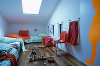 Three platform beds line the walls of this fun and fresh attic children's bedroom