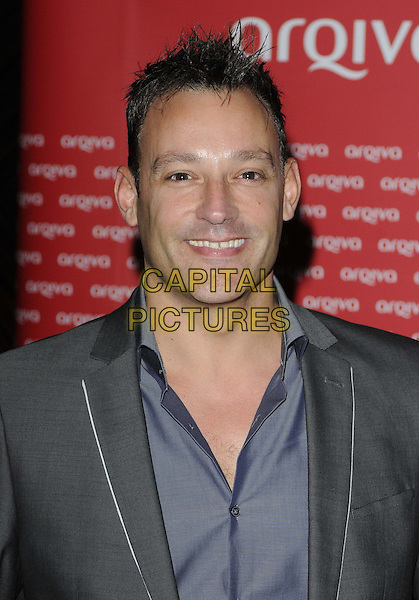 Toby Anstis.The Arqiva Commercial Radio Awards, Park Plaza Westminster Bridge Hotel, Westminster Bridge, London, England..July 4th, 2012.headshot portrait grey gray suit jacket blue shirt .CAP/CAN.©Can Nguyen/Capital Pictures.