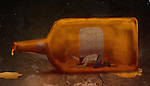 Illustrative concept of man in bottle representing alcohol addiction