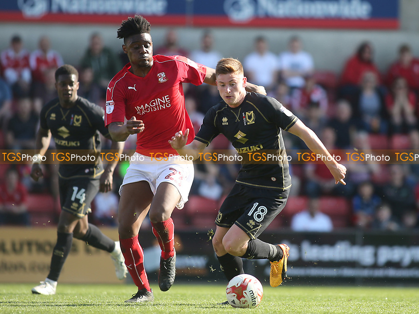 Harvey Barnes of MK Dons shields the ball from Swindon's  Rohan Ince during Swindon Town vs MK Dons, Sky Bet EFL League 1 Football at the County Ground on 8th April 2017