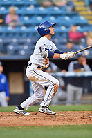 Asheville Tourists left fielder Terrin Vavra (6) swings at a pitch during game one of a double header against the Charleston RiverDogs at McCormick Field on April 9, 2019 in Asheville, North Carolina. The Tourists defeated the RiverDogs 17-3. (Tony Farlow/Four Seam Images)