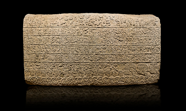 Hittite sculpted Orthostats panel from the  Long Wall.  Limestone, Kargarmis, Gaziantep, 900 - 700 BC,  Hieroglyph. Anatolian Civilisations Museum, Ankara, Turkey.<br /> <br /> In the epigraph with hieroglyph, he narrates that the gods were provoked against him, the account of the cities conquered and the spoils of war; that he allocated a share for the gods, and that he instigated the mighty king Tarhunza and the other gods. In the other lines, he demands that people should present offerings to statues but should evil-intentioned people be among them, such person individuals be punished by the gods.  <br /> <br /> On a black background.