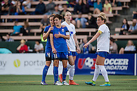Seattle, WA - Saturday, July 02, 2016: Seattle Reign FC defender Rachel Corsie (4) and Seattle Reign FC midfielder Keelin Winters (11) during a regular season National Women's Soccer League (NWSL) match between the Seattle Reign FC and the Boston Breakers at Memorial Stadium. Seattle won 2-0.