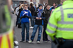 "Portsmouth 1 Southampton 1, 18/12/2012. Fratton Park, Championship. A group of young Portsmouth fans peering through a line of police officers in a street outside Fratton Park stadium before their club take on local rivals Southampton in a Championship fixture. Around 3000 away fans were taken directly to the game in a fleet of buses in a police operation known as the ""coach bubble"" to avoid the possibility of disorder between rival fans. The match ended in a one-all draw watched by a near capacity crowd of 19,879. Photo by Colin McPherson."