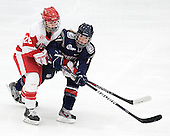 Louise Warren (BU - 28), Caitlin Hewes (UConn - 17) - The Boston University Terriers defeated the visiting University of Connecticut Huskies 4-2 on Saturday, November 19, 2011, at Walter Brown Arena in Boston, Massachusetts.