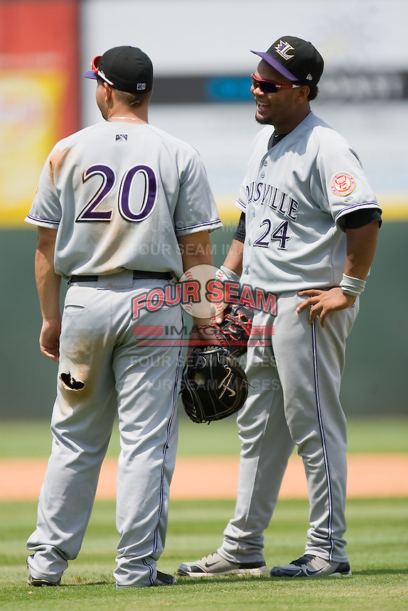 Juan Francisco #24 of the Louisville Bats jokes with teammate Yonder Alonso #20 during a pitching change at Knights Stadium July 20, 2010, in Fort Mill, South Carolina.  Photo by Brian Westerholt / Four Seam Images
