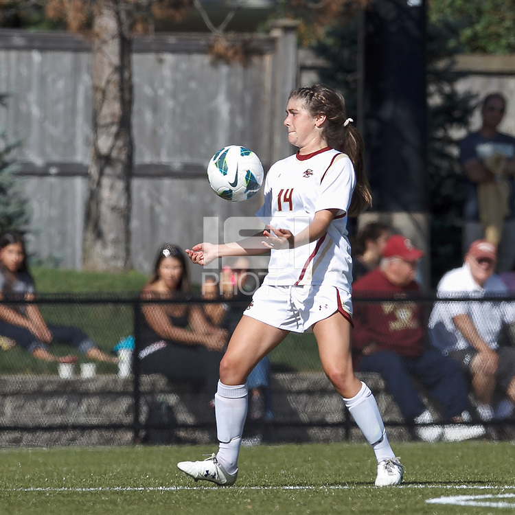 Boston College defender Madison Meehan (14) chest trap. Virginia Tech (maroon) defeated Boston College (white), 1-0, at Newton Soccer Field, on September 22, 2013.