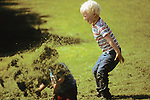 2 Kids Playing With Grass