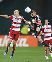 D.C. United midfielder Perry Kitchen (23) heads the ball against FC. Dallas midfielder Andrew Jacobson (4)  D.C. United defeated FC Dallas 4-1 at RFK Stadium, Friday March 30, 2012.