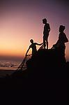 Fishermen on the beach in Colva in Goa in India.