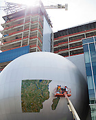 Workers apply a map of Madagascar to the Daily Planet at the Museum of Natural Sciences, Jones St., Raleigh, March 28, 2012.