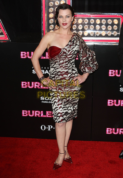 DEBI MAZAR.'Burlesque' Los Angeles Premiere held at The Grauman Chinese Theatre, Hollywood, CA, USA. .November 15th, 2010.full length grey gray silver red maroon burgundy print one shoulder dress lipstick nail varnish polish bracelets hands on hips shoes.CAP/ADM/KB.©Kevan Brooks/AdMedia/Capital Pictures.