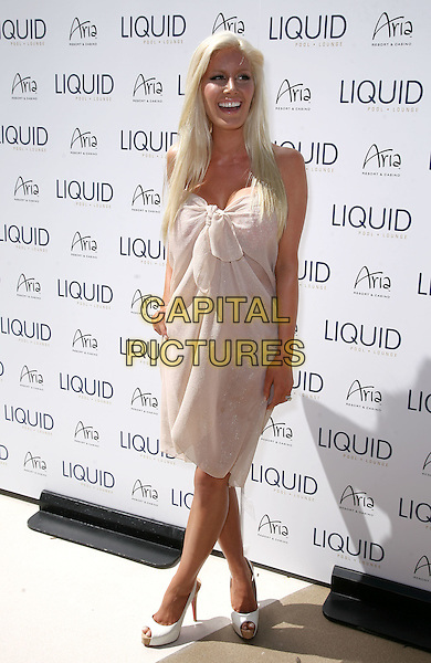 HEIDI MONTAG  .At the Liquid Grand Opening at Aria Resort and Casino at CityCenter,  Las Vegas, Nevada, USA, 10th April 2010..full length cream beige sarong wrap knotted white peep toe platform patent Christian louboutin shoes plastic surgery cosmetic hand on hip mouth open smiling  slingbacks cork .CAP/ADM/MJT.© MJT/AdMedia/Capital Pictures.