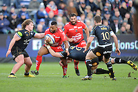 Steffon Armitage of RC Toulonis tackled by David Denton and Nick Auterac of Bath Rugby during the European Rugby Champions Cup match between Bath Rugby and RC Toulon - 23/01/2016 - The Recreation Ground, Bath Mandatory Credit: Rob Munro/Stewart Communications