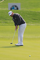 Brendan Grace (RSA) takes his putt on the 5th green during Sunday's Final Round of the 2014 BMW Masters held at Lake Malaren, Shanghai, China. 2nd November 2014.<br /> Picture: Eoin Clarke www.golffile.ie
