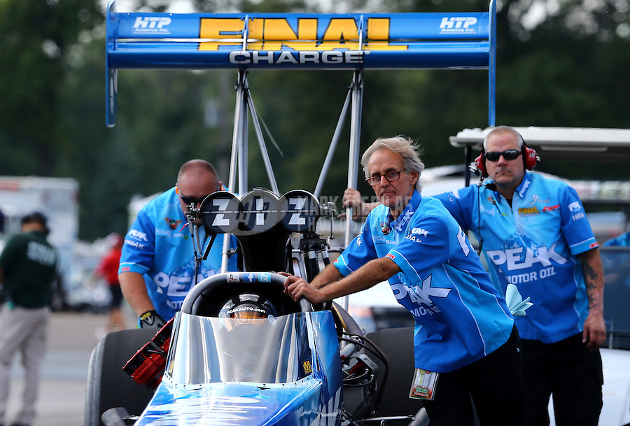 Aug. 16, 2013; Brainerd, MN, USA: Crew members for NHRA top fuel dragster driver T.J. Zizzo during qualifying for the Lucas Oil Nationals at Brainerd International Raceway. Mandatory Credit: Mark J. Rebilas-