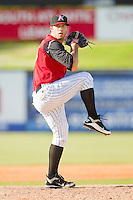 Kannapolis Intimidators relief pitcher Jarrett Casey #13 in action against the Hickory Crawdads at CMC-Northeast Stadium on April 8, 2012 in Kannapolis, North Carolina.  The Intimidators defeated the Crawdads 12-11.  (Brian Westerholt/Four Seam Images)