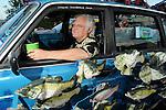 "David Shine sits in his car ""The Sashimi Tabernacle Choir"" at the 2010 Art Car Ball at the Orange Show Monument & Warehouse Thursday May 06,2010.  (Dave Rossman Photo)"