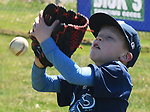 Preston Hayward 8 of Suffield, takes a  ball off his glove during a pop up drill,    Saturday, April 21, 2018, during the opening day of Suffield little league. (Jim Michaud / Journal Inquirer)