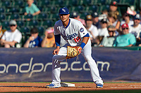 Travis Taijeron (18) of the Oklahoma City Dodgers ready at first base during a game against the Las Vegas 51s at Chickasaw Bricktown Ballpark on June 17, 2018 in Oklahoma City, Oklahoma. Oklahoma City defeated Las Vegas 5-3  (William Purnell/Four Seam Images)