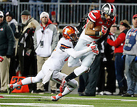 Ohio State Buckeyes wide receiver Devin Smith (9) catches a pass and gets tackled by Illinois Fighting Illini defensive back Zane Petty (21) during the second quarter of the NCAA football game at Ohio Stadium on Nov. 1, 2014. (Adam Cairns / The Columbus Dispatch)