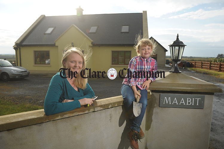 Esther O Rourke with her seven year old daughter Niamh outside their home at Clonreddan, Cree. Photograph by John Kelly.