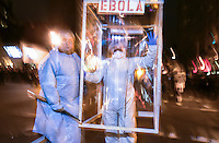 Two men wear customs that comment on the ebola fears the 41st Annual Halloween Parade. 10.31.2014. Photo by Marco Aurelio/VIEWpress