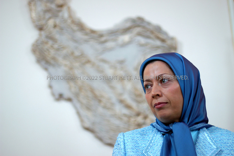 9/15/2005--Auvers-sur-Oise, France..Maryam Radjavi, born in 1953 in Tehran, is the leader of the Iranian opposition group, the National Council of Resistance of Iran (NCRI) based in the town Auvers-sur-Oise just outside Paris. Here she speaks to reporters, with a map of Iran behind, in the group's compound that was raided by French police in 2003 on suspicion of terrorist activities..Photograph By Stuart Isett.All photographs ©2005 Stuart Isett.All rights reserved.