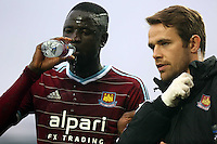 Sunday 07 December 2014<br /> Pictured: Cheikhou Kouyate of West Ham is seen by team physiotherapists after he got injured<br /> Re: Premier League West Ham United v Swansea City FC at Boleyn Ground, London, UK.