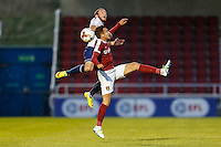 Lawson D'Ath of Northampton Town and Michael Harriman of Wycombe Wanderers in an aerial battle during the The Checkatrade Trophy match between Northampton Town and Wycombe Wanderers at Sixfields Stadium, Northampton, England on 30 August 2016. Photo by David Horn / PRiME Media Images.