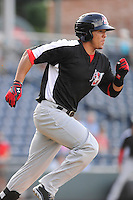 Catcher Jorge Alfaro (11) of the Hickory Crawdads in a game against the Greenville Drive on Friday, June 7, 2013, at Fluor Field at the West End in Greenville, South Carolina. Alfaro is the No. 9 prospect of the Texas Rangers, according to Baseball America. Greenville won the resumption of this May 22 suspended game, 17-8. (Tom Priddy/Four Seam Images)
