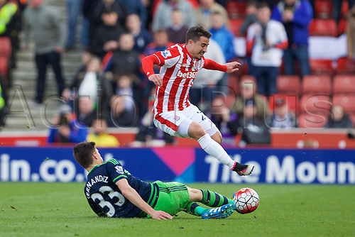 02.04.2016. Britannia Stadium, Stoke, England. Barclays Premier League. Stoke City versus Swansea City.  Stoke City forward Bojan Krkic jumps over the tackle from Swansea City defender Federico Fernandez.