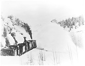 D&amp;RGW rotary snow plow OM being pushed by #216 C-16 and several other engines.<br /> D&amp;RG  Cumbres, CO  Taken by Ballough, Monte - 3/1909